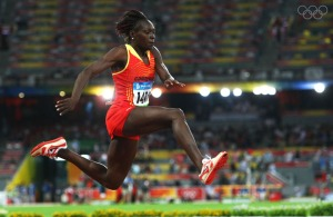 BEIJING - AUGUST 17: Francoise Mbango Etone of Cameroon competes in the Women's Triple Jump Final held at the National Stadium on Day 9 of the Beijing 2008 Olympic Games on August 17, 2008 in Beijing, China.  (Photo by Alexander Hassenstein/Bongarts/Getty Images)